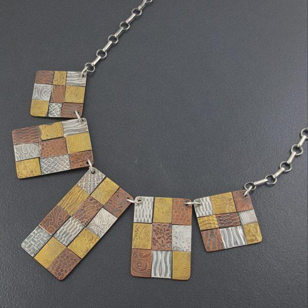 mixed metal bib necklace