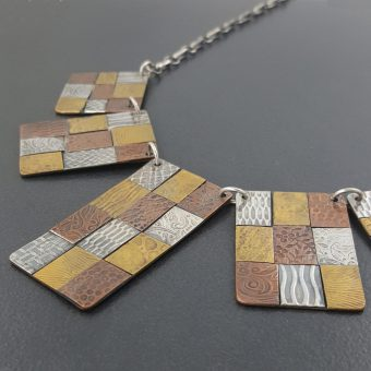 mixed metal bib necklace - Michele Grady